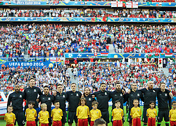 LYON, FRANCE - Wednesday, July 6, 2016: Wales players sing the national anthem before the UEFA Euro 2016 Championship Semi-Final match against Portugal at the Stade de Lyon. captain Ashley Williams, goalkeeper Wayne Hennessey, Neil Taylor, James Chester, Andy King, Joe Allen, Hal Robson-Kanu, Joe Ledley, Gareth Bale, James Collins and Chris Gunter. (Pic by David Rawcliffe/Propaganda)