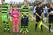 The Silent Child star Maisie Sly with Forest Green Rovers Lee Collins(5) during the EFL Sky Bet League 2 match between Forest Green Rovers and Mansfield Town at the New Lawn, Forest Green, United Kingdom on 24 March 2018. Picture by Shane Healey.