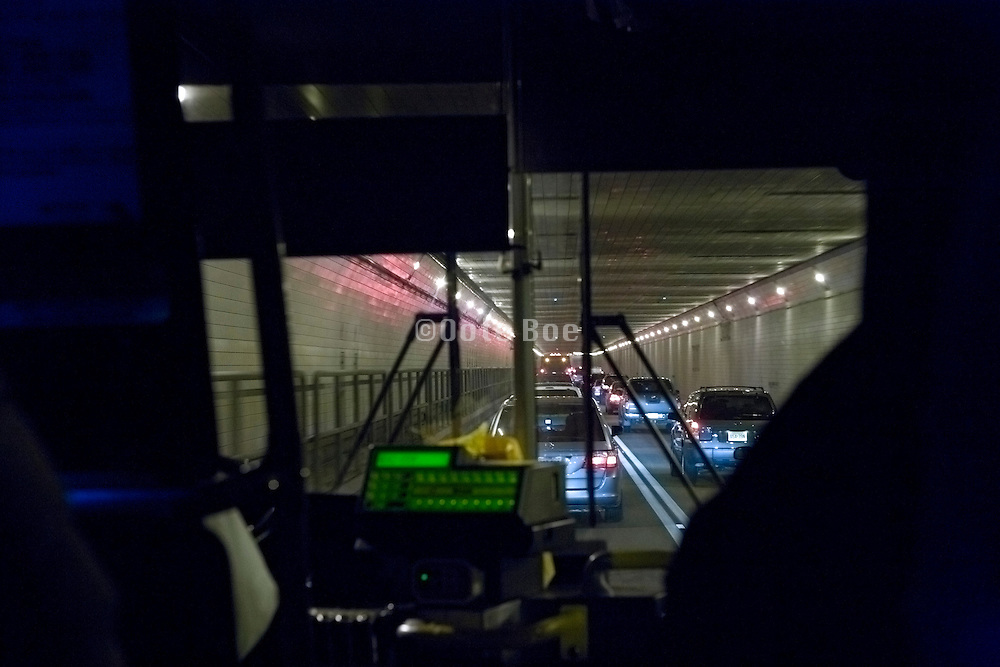 a public transportation  bus driving through the Lincoln tunnel New York City