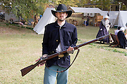 Arkansas, AR, USA, Old Washington State Park, Civil War Weekend, A confederate soldier holding a musket