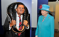 Queen Elizabeth ll watches Tommy Mattinson, the world gurning champion, during a visit to the Beacon Museum in Whitehaven, Cumbria on June 5, 2008.....
