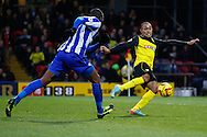 Picture by David Horn/Focus Images Ltd +44 7545 970036<br /> 14/12/2013<br /> Ikechi Anya of Watford (right) shoots while Reda Johnson of Sheffield Wednesday chases him down during the Sky Bet Championship match at Vicarage Road, Watford.