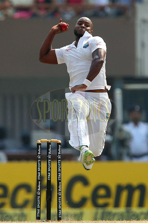 Tino Best of West Indies bowls during day two of the first Star Sports test match between India and The West Indies held at The Eden Gardens Stadium in Kolkata, India on the 7th November 2013<br /> <br /> Photo by: Ron Gaunt - BCCI - SPORTZPICS