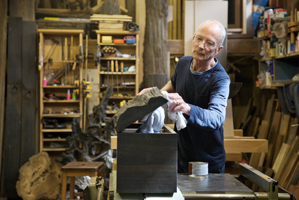Furniture maker Adrian Swintead polishing an almost finished piece in his Maulden Woods studio, Bedfordshire<br /> CREDIT: Vanessa Berberian for The Wall Street Journal<br /> GURU-SWINSTEAD