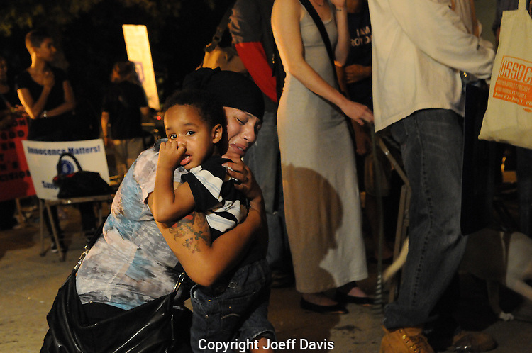 Atlanta, Georgia - September  21, 2011: After the announcement that Troy Davis' execution will be moving forward Ariana Lima hugs her son Zion &quot;in fear,&quot; she said, &quot;that this is the world that Zion will be inheriting.&quot;<br />