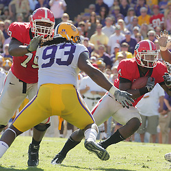 25 October 2008:  Georgia running back Caleb King (4) runs past LSU defensive end Tyson Jackson (93) during the Georgia Bulldogs 52-38 victory over the LSU Tigers at Tiger Stadium in Baton Rouge, LA.