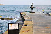 Statue of a boy with a fish on the shore of the Mediterranean Sea by Yiota Ioannidou, Paphos, Cyprus