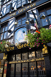 London, England: The George, a drinking establishment on Fleet Street, was founded as a coffee house in 1723.  Its distinctive facade appears to be 17th century half-timbered, but it actually is a late Victorian reproduction.  Still, it adds a bit of style and color to the area around the Royal Courts of Justice.