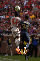 July 28, 2018 - Ann Arbor, MI, U.S. - ANN ARBOR, MI - JULY 28: Liverpool Midfielder Rafael Camacho (64) and Manchester United Defender Demetri Mitchell (35) go up for a free ball in the ICC soccer match between Manchester United FC and Liverpool FC on July 28, 2018 at Michigan Stadium in Ann Arbor, MI (Photo by Allan Dranberg/Icon Sportswire) (Credit Image: © Allan Dranberg/Icon SMI via ZUMA Press)