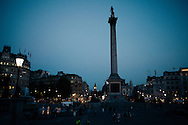 trafalgar square in london at dusk
