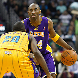 February 5, 2011; New Orleans, LA, USA; Los Angeles Lakers shooting guard Kobe Bryant (24) is guarded by New Orleans Hornets small forward Quincy Pondexter (20) during the first quarter at the New Orleans Arena.   Mandatory Credit: Derick E. Hingle
