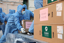 MANZHOULI, April 17, 2020  Staff members transfer medical supplies at an airport in the China-Russia border city of Manzhouli in north China's Inner Mongolia Autonomous Region, April 17, 2020. The medical supplies were allocated by the National Health Commission from Wuhan-based Union Hospital and Tongji Hospital, which are both affiliated to Tongji Medical College of Huazhong University of Science and Technology. (Credit Image: © Zou Jianpu/Xinhua via ZUMA Wire)