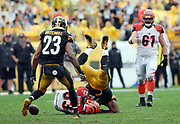 Pittsburgh Steelers free safety Mike Mitchell (23) looks on as Pittsburgh Steelers outside linebacker James Harrison (92) gets upended while causing a fumble as he hits Cincinnati Bengals wide receiver Tyler Boyd (83) on a fourth quarter pass reception (fumble recovered by the Steelers) during the 2016 NFL week 2 regular season football game against the Cincinnati Bengals on Sunday, Sept. 18, 2016 in Pittsburgh. The Steelers won the game 24-16. (©Paul Anthony Spinelli)