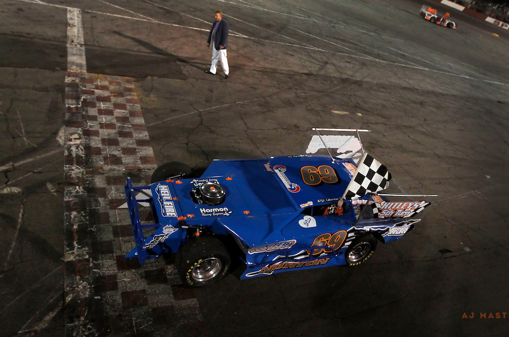 11 September 2010: RJ Norton Jr, of Indianapolis, drives with the checkered flag after winning the 34th Annual World Figure 8 Championship at the Speedrome in Indianapolis, Saturday, Sept. 11, 2010.
