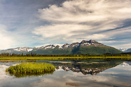 Reflection of Chugach Mountains in Robe Lake near Valdez in Southcentral Alaska. Summer. Morning.