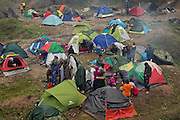 Greece, Idomeni, Refugees on their way to Europe - Eye of a Needle, Idomeni<br /> <br /> Refugees waiting that Macedonia reopens the border so they can keep the way up to North Europe.<br /> <br /> Nadeloehr nach Nordeuropa Idomeni, der Grenzuebergang ist seit Tagen gesperrt,. <br /> Es ensteht im provisorischen Fluechtlingslager in Idomeni eine ngespannte Lage. <br /> Daueregen und Kaelte machen vor allem den Familien mit kleinen Kindern zu schaffen. <br /> <br /> Idomeni, is the eye of a needle for getting to nothern Europe. <br /> The FYRO macedonian authorities, closed the border from Greece completely. The situation close to the border gets more and more difficult. The People have to sleep outside or in small tents. <br /> Heavy rainfalls and cold nights are treating the refugees badly. Some already stayed up to ten nights at Idomeni. There is not enough food and supplies to help about 14.000 refugees.<br /> <br /> <br /> <br /> keine Veroeffentlichung unter 50 Euro*** Bitte auf moegliche weitere Vermerke achten***Maximale Online-Nutzungsdauer: 12 Monate !! <br /> <br /> for international use:<br /> Murat Tueremis<br /> C O M M E R Z  B A N K   A G , C o l o g n e ,  G e r m a n y<br /> IBAN: DE 04 370 800 40 033 99 679 00<br /> SWIFT-BIC: COBADEFFXXX