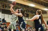 Rice's Rachel Chicoine (21) leaps for a lay up during the girls basketball game between the Burlington Sea Horses and the Rice Green knights at Rice Memorial high school on Thursday night February 18, 2016 in South Burlington. (BRIAN JENKINS/for the FREE PRESS)