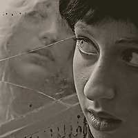 Close up of teenagers face with reflection in mirror
