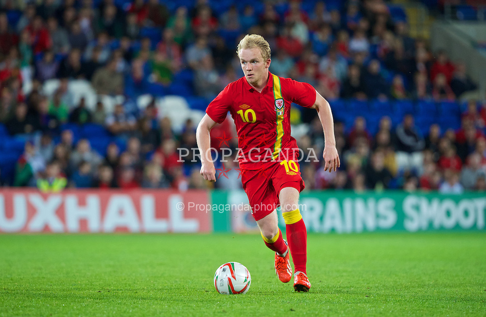 CARDIFF, WALES - Wednesday, August 14, 2013: Wales' Jonathan Williams in action against Republic of Ireland during an International Friendly at the Cardiff City Stadium. (Pic by David Rawcliffe/Propaganda)