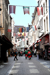 Brussels is the capital of Belgium and the de facto capital of the European Union (EU). It is also the largest urban area in Belgium, comprising 19 municipalities, including the municipality of the City of Brussels, which is the capital of Belgium, in addition to the seat of the French Community of Belgium and of the Flemish Community.  Brussels has grown from a 10th-century fortress town founded by a descendant of Charlemagne into a metropolis of more than one million inhabitants.[10] The metropolitan area has a population of over 1.8 million, making it the largest in Belgium.