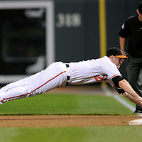 09 June 2009:  Baltimore Orioles first baseman Aubrey Huff (17) makes a diving attempt at a double down the line off the bat of Seattle Mariners left fielder Endy Chavez in the 2nd inning at Camden Yards in Baltimore, MD.  The Orioles defeated the Mariners 3-1.  ****For Editorial Use Only****