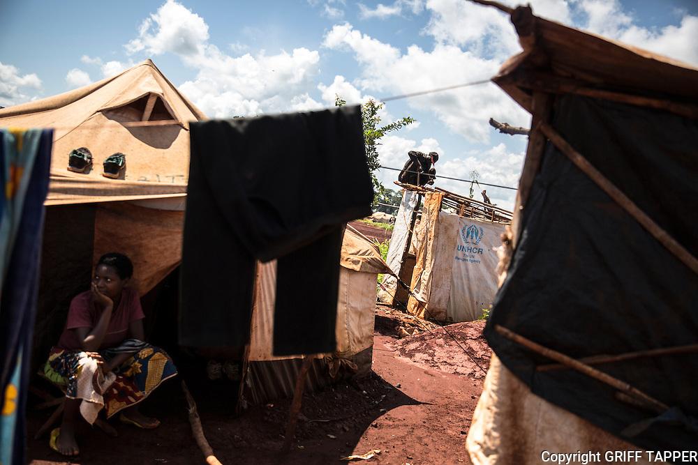 A man makes repairs to a temporary shelter at the Nyarugusu refugee camp in Tanzania.