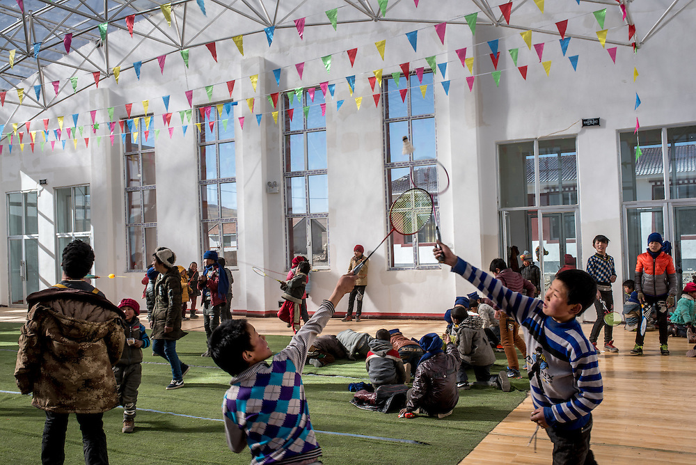 Students play in Ngam-nak's indoor gymnasium during a break from classes. With temperatures reaching well below freezing, the building provides necessary shelter for playing students during TIbet's winter. Ngam-nak serves as a school for Tibetan nomadic children, who are dropped off by their parents and spend 8 months a year in the remote settlement until they have completed a basic level of education. Staffed by a handful of teachers and cooks, there are no other activities in Ngam-nak apart from the school.