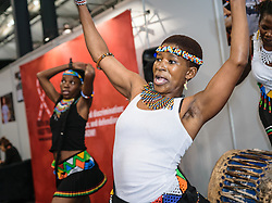 Sharon Mthembu (right), and other members of Uthando Iwethu ('Our Love'), the IDOLO Performing Arts Group, play and dance in the Interfaith Networking Zone at the 2016 International AIDS Conference in Durban, South Africa.