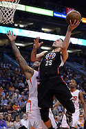 PHOENIX, AZ - APRIL 13:  Austin Rivers #25 of the Los Angeles Clippers drives the ball against P.J. Tucker #17 of the Phoenix Suns in the first half at Talking Stick Resort Arena on April 13, 2016 in Phoenix, Arizona.  NOTE TO USER: User expressly acknowledges and agrees that, by downloading and or using this photograph, User is consenting to the terms and conditions of the Getty Images License Agreement. (Photo by Jennifer Stewart/Getty Images)