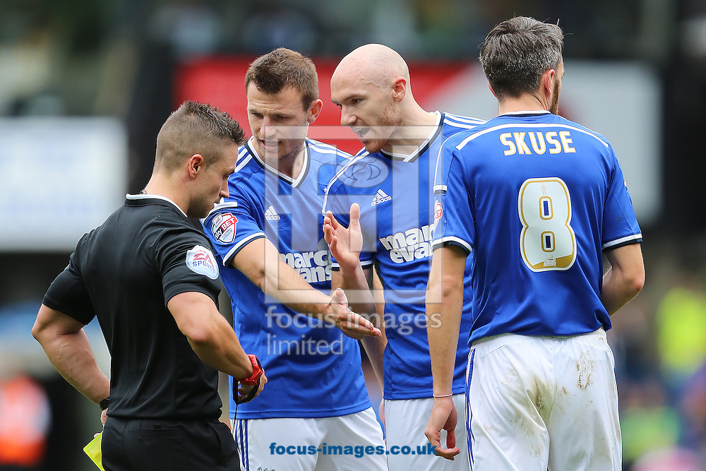 Tommy Smith and Conor Sammon of Ipswich Town complain to Referee, James Adcock during the Sky Bet Championship match against Blackburn Rovers at Portman Road, Ipswich<br /> Picture by Richard Calver/Focus Images Ltd +447792 981244<br /> 18/10/2014