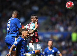 Wes Morgan of Leicester City (L) and Emmanuel Emenike of West Ham United in action - Mandatory by-line: Jack Phillips/JMP - 17/04/2016 - FOOTBALL - King Power Stadium - Leicester, England - Leicester City v West Ham United - Barclays Premier League