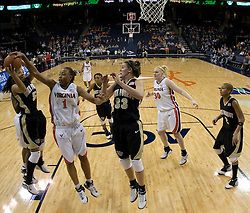 Virginia's Lyndra Littles (1) tries to grab the ball from Wake Forest's Courteney Morris (5).  The Cavaliers defeated the Demon Deacon 77-71 on January 11, 2007 for their first ACC win in the John Paul Jones Arena in Charlottesville, VA.<br />