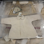 BOWIE, MD - MAY3: A child's dress saved from a displaced persons camp near Bergen-Belsen in Germany, after World War II, is now carefully stored at the U.S. Holocaust Memorial Museum's David and Fela Shapell Family Collections, Conservation and Research Center in Bowie, MD, May 3, 2017. The dress was worn by more than a dozen other brides in the displaced persons camp.<br /> <br /> The 80,000-square-foot Shapell Center is a state-of-the-art facility that will house the collection of record of the Holocaust, including historical artifacts, documents, photographs, film and other objects related to the Holocaust. (Photo by Evelyn Hockstein/For The Washington Post)