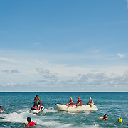 Jet-ski and banana boat with swimmers, Baishawan, Kenting, Pingtung County, Taiwan.