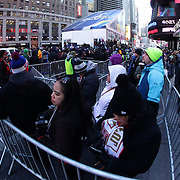 Fan queue to see and photograph theVince Lombardi Trophy during Super Bowl week activities in Times Square, New York, USA. 29th January 2014. Photo Tim Clayton