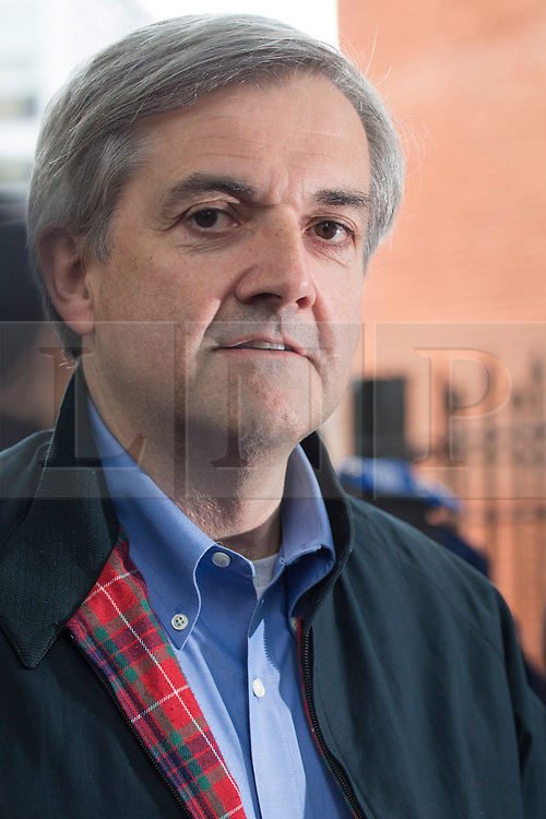 © licensed to London News Pictures. London, UK 13/05/2013. Chris Huhne giving a statement to the media outside his house in London after being released from prison on Monday, 13 May 2013. Photo credit: Tolga Akmen/LNP