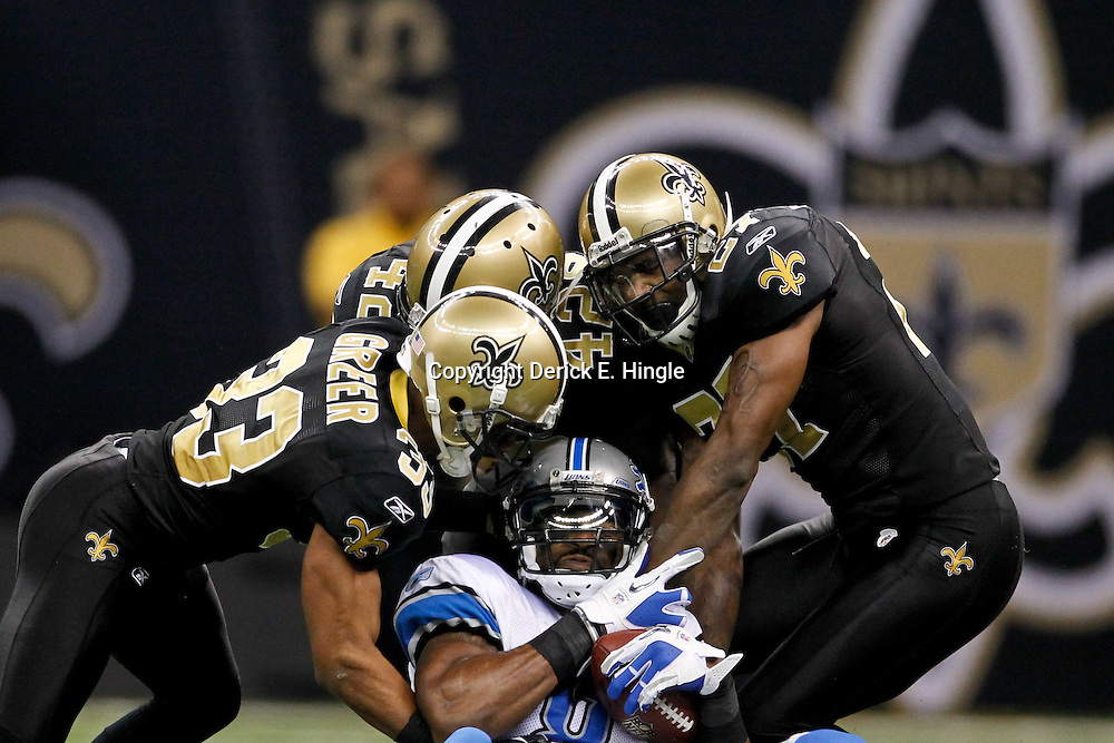 January 7, 2012; New Orleans, LA, USA; New Orleans Saints cornerback Jabari Greer (33), safety Isa Abdul-Quddus (42) and safety Malcolm Jenkins (27) combine to tackle Detroit Lions wide receiver Calvin Johnson (81) during the 2011 NFC wild card playoff game at the Mercedes-Benz Superdome. Mandatory Credit: Derick E. Hingle-US PRESSWIRE