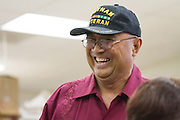 Veterans Supportive Services Agency, Inc.'s Tito A. Cortez (United States Army, Vietnam) talks with FedEx employees as they build two playhouses at the Habitat For Humanity shop in Milpitas, Calif., on Sept. 11, 2012.  Photo by Stan Olszewski/SOSKIphoto.