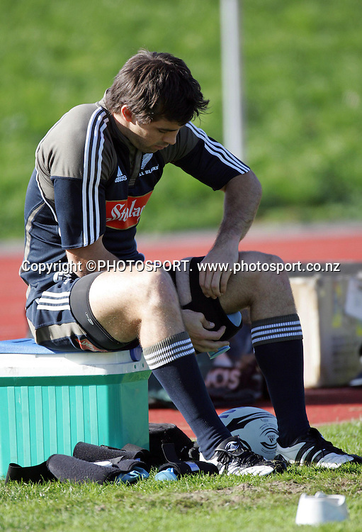 Conrad Smith rests his leg during the All Blacks training session held at Waitakere Stadium, Auckland, on Tuesday 29 May 2007. Photo: Andrew Cornaga/PHOTOSPORT<br /><br /><br />290507