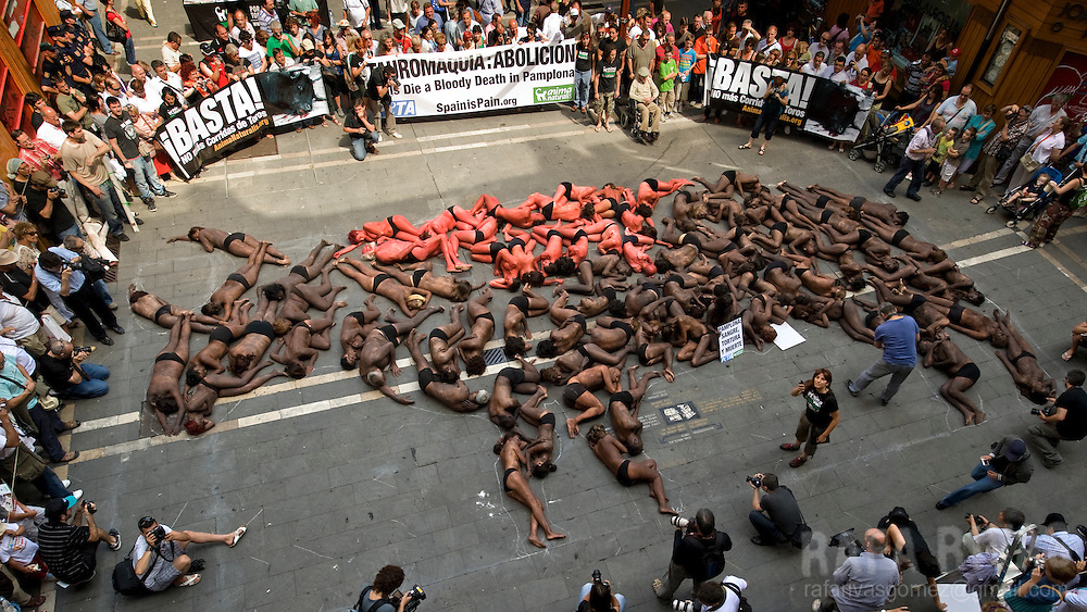 Members of PETA and Anima Naturalis pro animal groups, lie on the ground in front of the Town Hall, to create a fighting bull shape, during a protest against bullfighting, in the Northern Spanish city of Pamplona, on July 4, 2010.  PHOTO/Rafa Rivas