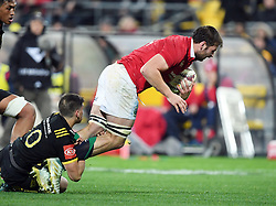 """Iain Henderson of the Lions tackled by Otere Black of the Hurricanes in the International rugby match between the the Super Rugby Hurricanes and British and Irish Lions at Westpac Stadium, Wellington, New Zealand, Tuesday, June 27, 2017. Credit:SNPA / Ross Setford  **NO ARCHIVING"""""""