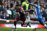 Norwich City's midfielder Nathan Redmond gets away from Rohan Ince, Brighton midfielder during the Sky Bet Championship match between Brighton and Hove Albion and Norwich City at the American Express Community Stadium, Brighton and Hove, England on 3 April 2015.