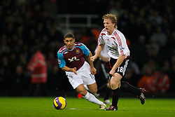 LONDON, ENGLAND - Wednesday, January 30, 2008: Liverpool's Dirk Kuyt and West Ham United's Hayden Mullins during the Premiership match at Upton Park. (Photo by David Rawcliffe/Propaganda)