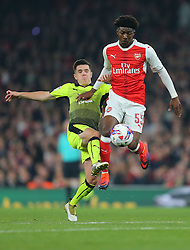 25 October 2016 - EFL Cup - 4th Round - Arsenal v Reading - Ainsley Maitland-Niles of Arsenal in action with Liam Kelly of Reading - Photo: Marc Atkins / Offside.