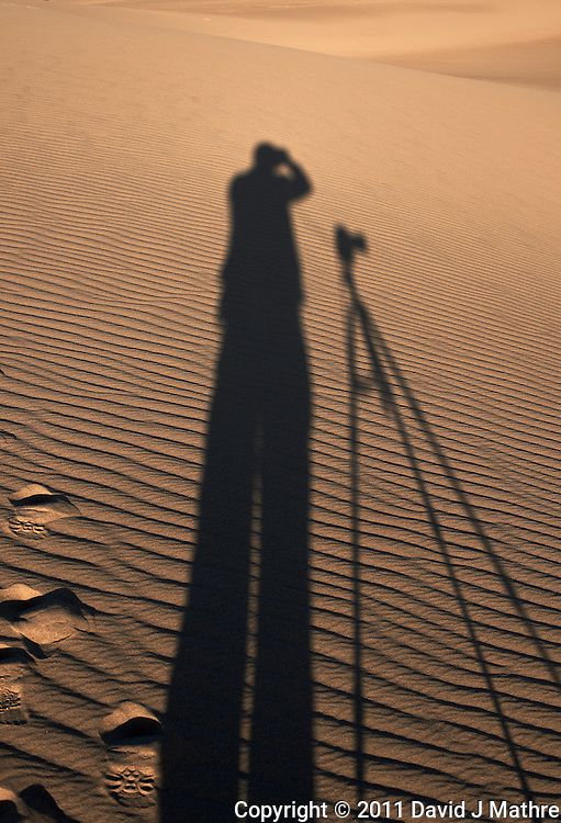 Early Morning Shadow of a Photographer on the Dunes in Death Valley National Park in California. Image taken with a Nikon D3x and 50 mm f/1.4G lens (ISO 100, 50 mm, f/8, 1/250 sec).