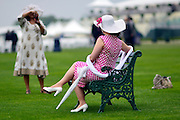 © London News Pictures. 20/06/2013. Ascot, UK. A couple of friends tai photographs of each other. Ladies Day on day three of Royal Ascot at Ascot racecourse in Berkshire, on June 20, 2013. The 5 day showcase event, which is one of the highlights of the racing calendar, has been held at the famous Berkshire course since 1711 and tradition is a hallmark of the meeting. Top hats and tails remain compulsory in parts of the course.  Photo credit : Stephen Simpson/LNP