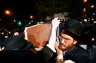 The body of Grand Rabbi Moses Teitelbaum, worldwide spiritual leader of tens of thousands of members of the ultra-Orthodox Jewish sect, Satmar Hassidim, is carried in a funeral procession in Brooklyn, New York after he died in New York City at the age of 91 Monday 24 April 2006.