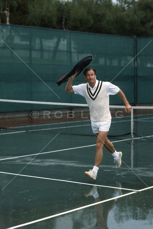 Tennis Player caught on the court in the rain