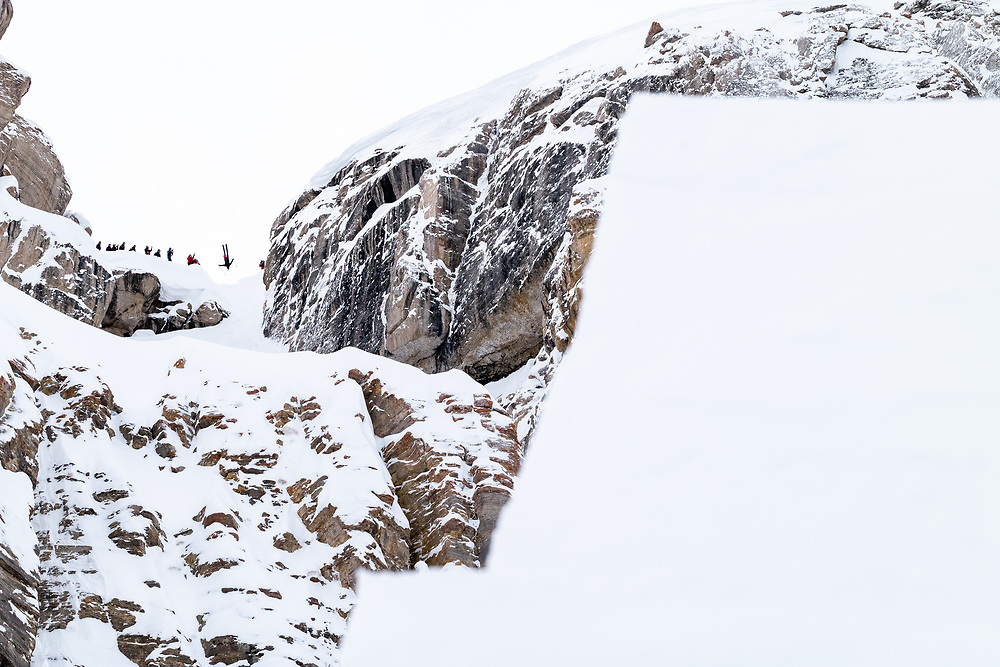 Teton Brown backflipping his second run with the bottom jump looming in the foreground.