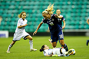 Antria Michail (#8) of Cyprus slides in to win the ball from Claire Emslie (#18) of Scotland during the Women's Euro Qualifiers match between Scotland Women and Cyprus Women at Easter Road, Edinburgh, Scotland on 30 August 2019.